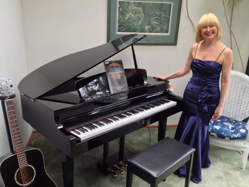 Kathy Jenkins with the piano she learned to play as she recovered from brain surgery at VGH.